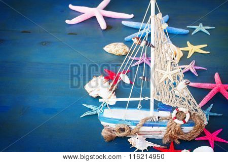 Seashells,  starfish and boat  with copy space