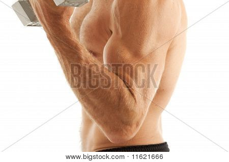 Young man lifting weights