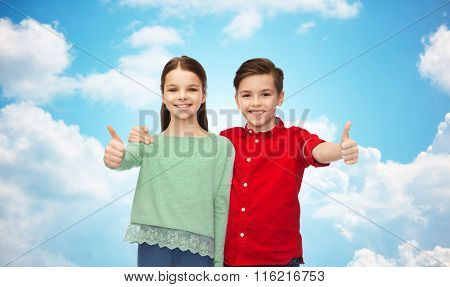 happy boy and girl showing thumbs up