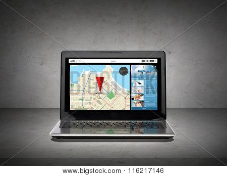 laptop computer with gps navigator map on screen