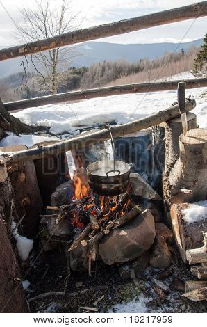 Cooking In Field Conditions, Boiling Pot At The Campfire On Picnic, Mountains,