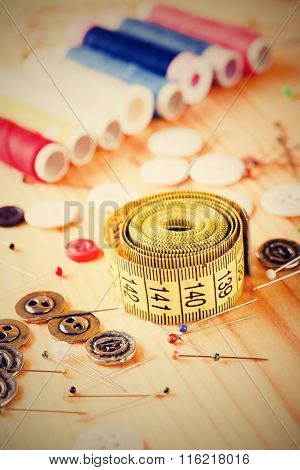 Vintage Photo Of Measuring Tape Among Other Sewing Accessories