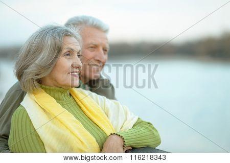 Happy senior couple  near river