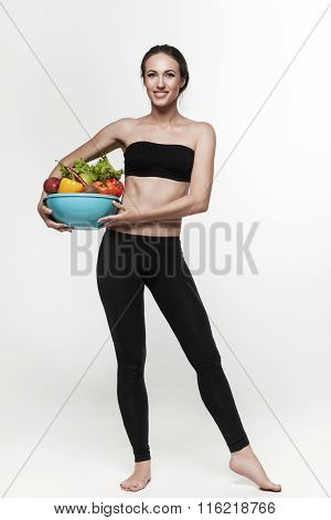 Portrait Of Young Fit Woman Eating Vegetables