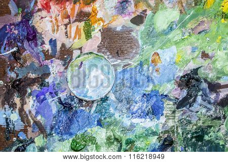 The Palette Of Artist With A Cup For Mixing Oil Paints