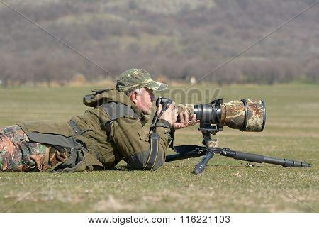 wildlife photographer outdoor in action