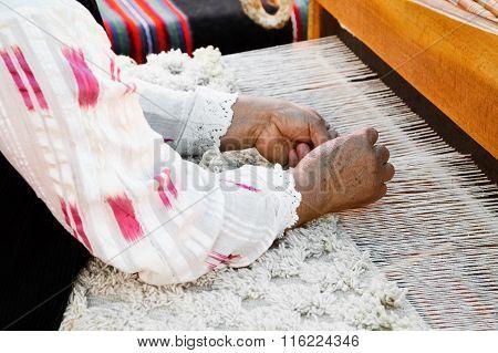 Elderly Woman In Lace Shirt Doing Weaving