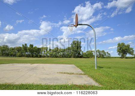 Lone rim and backboard in a park
