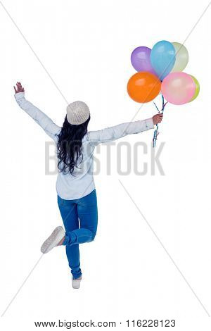 Asian woman holding colorful balloons on white screen