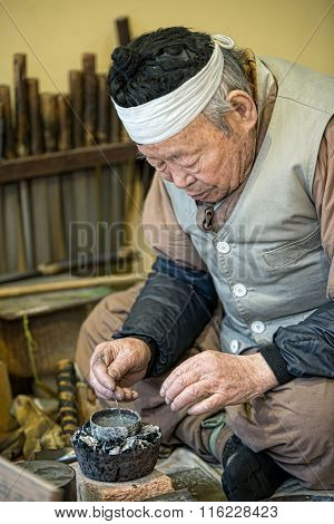 Korea traditional copper pipe tobacco production craftsmen