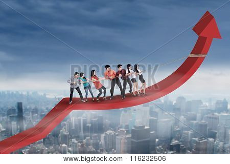 Business Team Pulling Arrow Upward