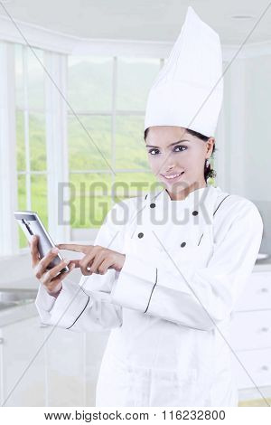 Chef Using Cellphone In The Kitchen