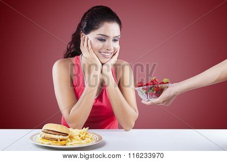 Happy Woman Choosing Strawberry