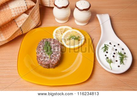 Raw Cutlets With Lemon Slices On A Cutting Board