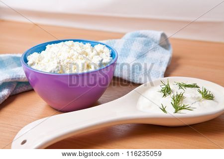 Cottage Cheese In A Bowl Next To A Large Dollop Of Sour Cream