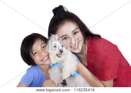 Woman And Her Daughter With Maltese Dog