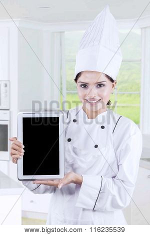 Woman With Chef Uniform Showing Tablet