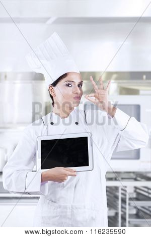 Young Chef With Deliciousness Gesture And Tablet