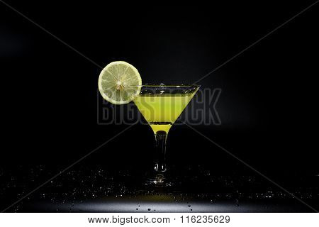 A Glass Of Juice Is Standing On A Black Table