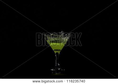 Lime Dropped Into A Glass Of Lime Juice