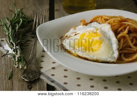 Spaghetti With Tomato Paste And Fried Egg