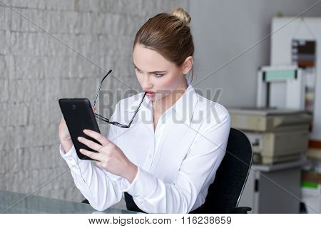 Businesswoman Read Bad News On Tablet