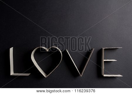 the word love made up of cardboard letters