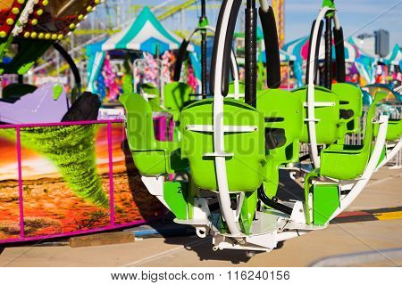 Green Chair Ride In An Amusement Park
