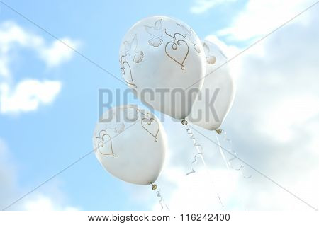 Three love balloons in the sky
