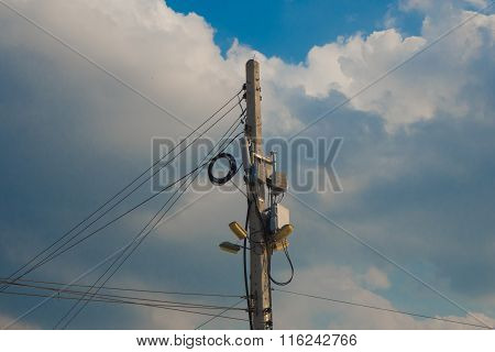 Electric Pole And Antenna With Blue Sky