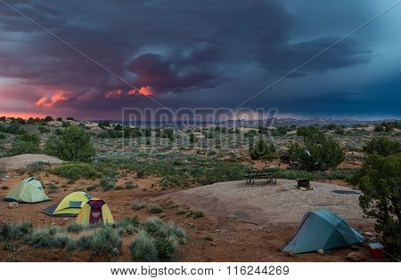 Tents In Desert With Pink Thunder Storm Sky