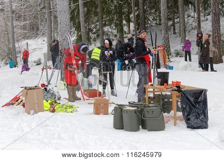 Officials Fixing Skies And Offer Water And Blueberry Soup To The Cross Country Skiers