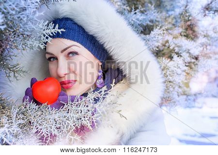 Portrait Of Beautiful Woman And Red Heart