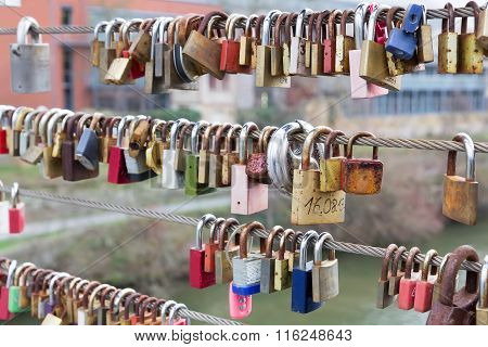 Love Padlocks Hanging From Railing On Bridge