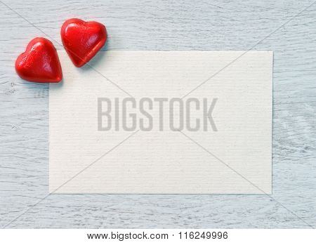 Valentine's Day candies and old paper for congratulation