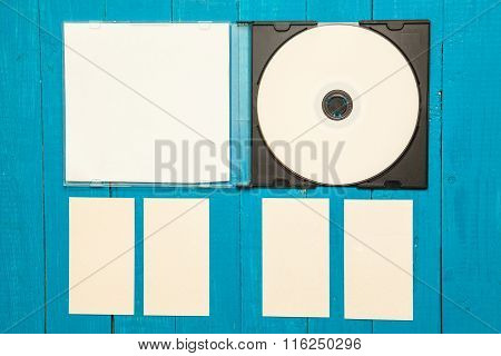 Dvd Rom And Business Cards On A Wooden Background. Mock-up For Branding Identity.