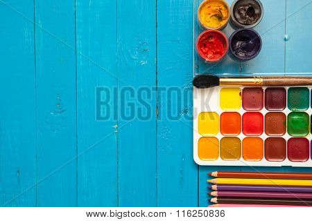 Brush And Paint On A Wooden Background