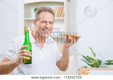 Content adult man drinking beer