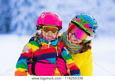 Mother And Little Girl Learning To Ski