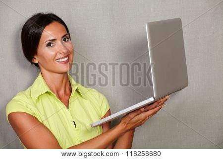 One Young Woman While Holding Laptop