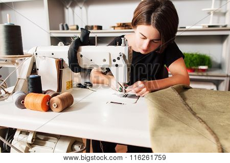 Seamstress  Put Thread In Needle. Tailor's Workplace