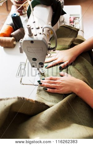 Seamstress Sews Clothes