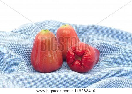 Rose Apple On Blue Cloth Background