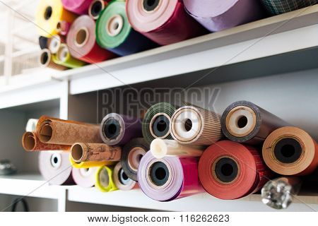 Many Colorful Rolls Of Wrapping Paper