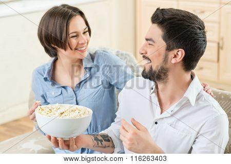 Vivacious couple watching TV