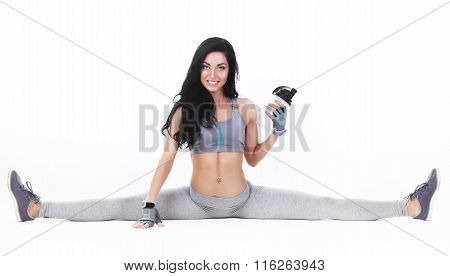 Slender Young Woman Doing Sport Exercises On White Background