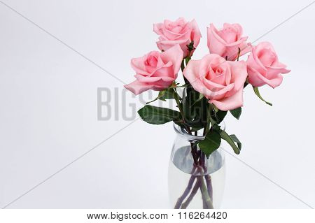 Glass Vase Of Pink Roses