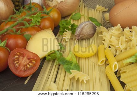 Pasta and vegetables on a wooden table