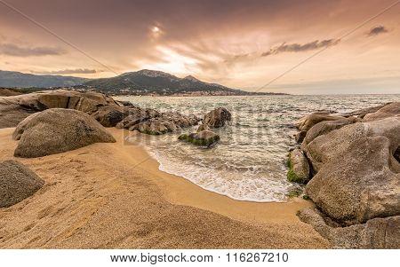 Rocks And Sand At Algajola Beach In Corsica