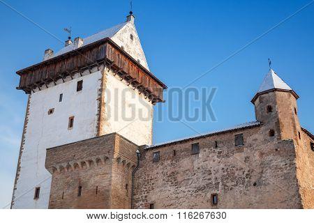 Herman Castle Facade Fragment Over Blue Sky. Narva